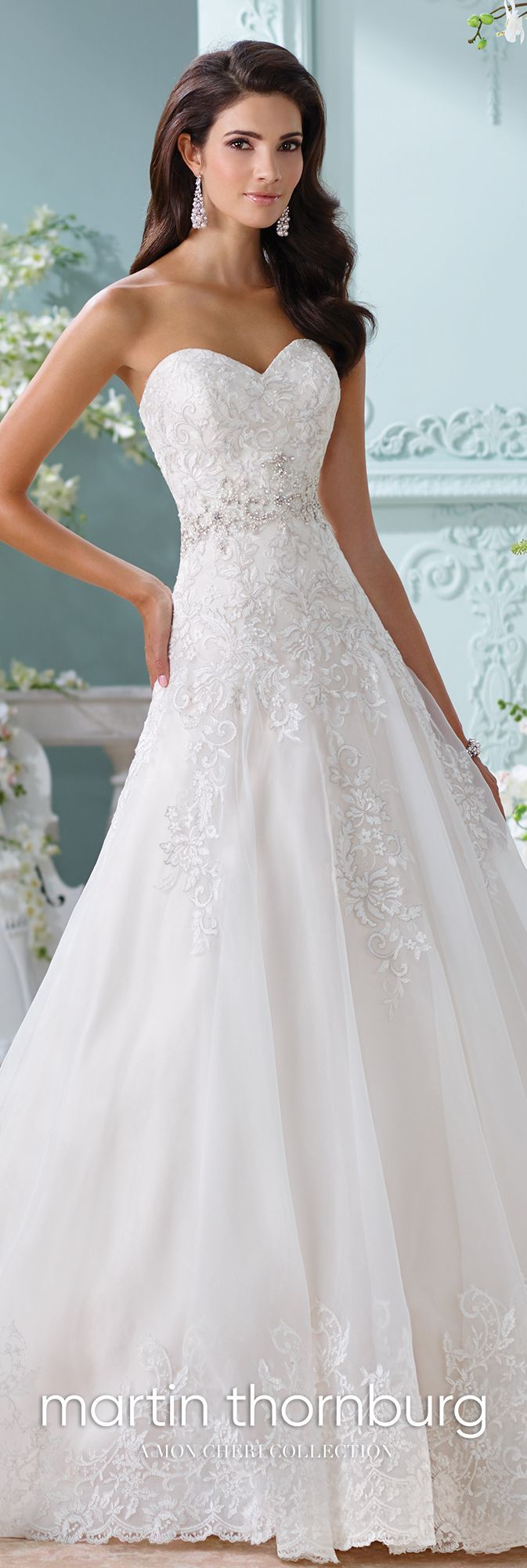 Martin Thornburg 116210 – Laina - Strapless organza and lace Aline wedding dress, metallic Schiffli lace appliqués over satin gown with sweetheart neckline, hand-beaded jeweled motif at natural waist, scalloped hem and chapel length train, detachable spaghetti and halter straps included. #satinweddingdresses