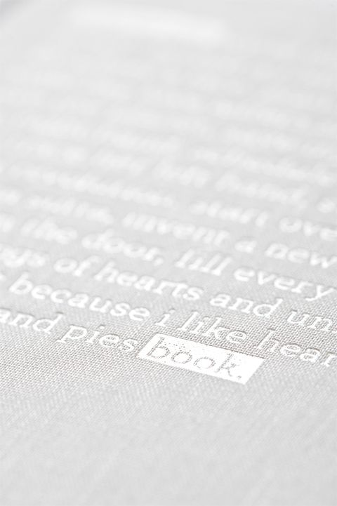 White Foil Stamp Hardcover via http://www.underconsideration.com/fpo/archives/2009/05/zync-journal.php