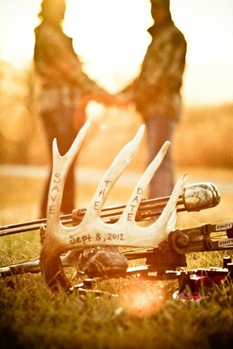 save the date with antlers and bow with camouflage~ Joe would give his left leg if I let him do this lol!