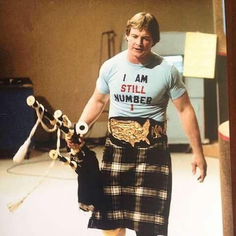 """Rowdy Roddy Piper wearing his homemade """"I Am Still Number 1"""" t-shirt"""