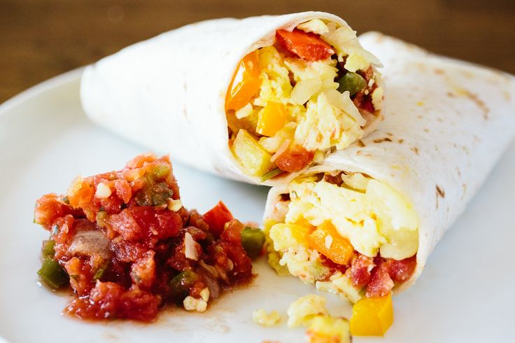 Burritos with eggs, cheese, and potatoes, made ahead and heated up quickly on a weekday morning. Breakfast victory!