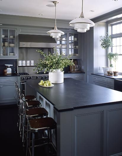 medium grey cabinets, black counter probably too much grey (i wouldn