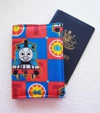 """CHILD'S PASSPORT COVER/FOLDER/WALLET - THOMAS TANK ENG. by Graggie Australia*GA- via ebay*DESCRIPTION    SIZE:  20cm x 14 cm (8"""" x 5.5"""").hold 2 Passports when used as a Wallet/Folder.      Comes sealed in a polypropelene bag and is ready to wrap for that perfect gift.Can be matched up with other items to make a lovely gift set.  Made from designer quality quilters cotton  and stiffened for duarability."""