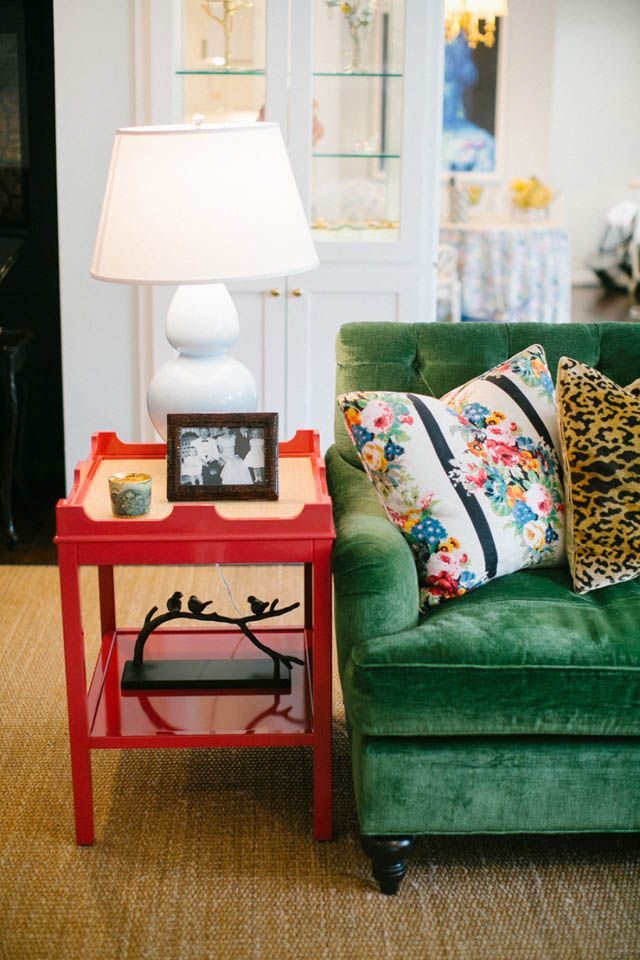 Ikea Green velvet sofa, my end tables painted coral, tiger print pillow & add some cool lamps