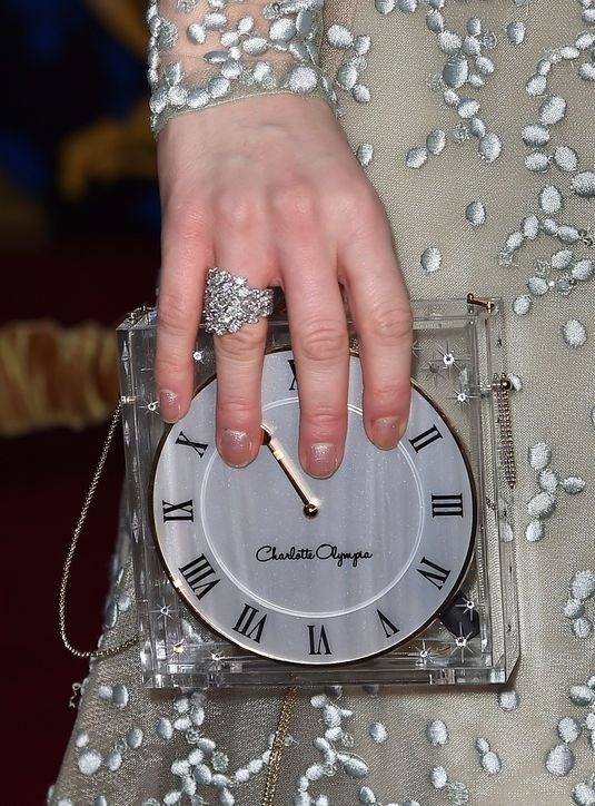 Lily James' Charlotte Olympia clock clutch at the Cinderella premiere