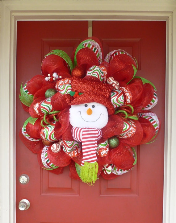 snowman christmas deco mesh wreath make a basic wreath using basic holiday colors and use a large lightweight decorative item from the dollar store to - Decorative Wreaths