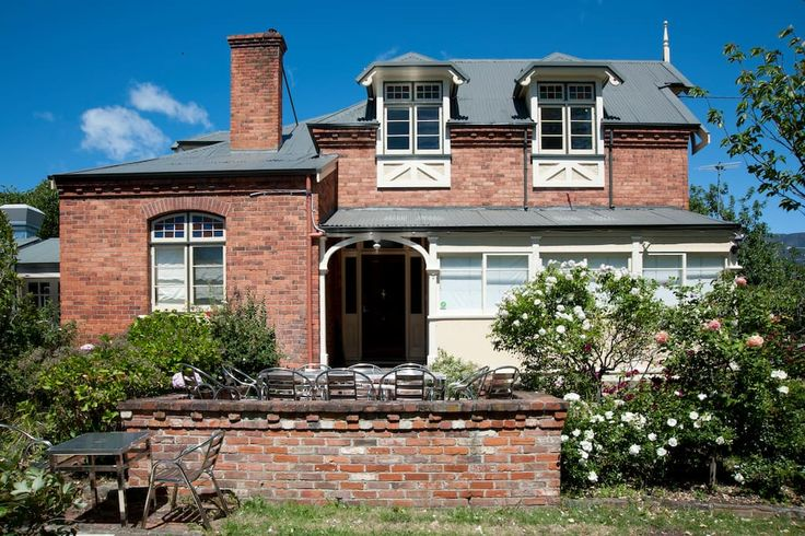 House in Hobart, Australia. This charming historic house was built in 1897 and today provides an oasis in the Hobart city fringe. This property has 5 bedrooms with 1 super-king and 5-queen beds, a beautiful private established garden and adjoins a cute modern cafe.  Base you...