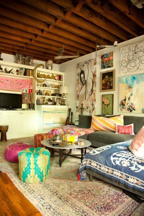 Clashing wall art, patterns and accents creates an eclectic decor scheme.