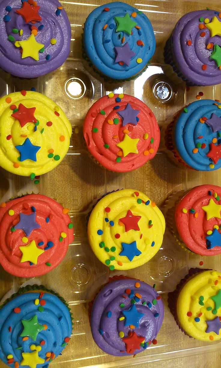 Bright cupcakes to match Wiggles cake by Monicakes Warren, MI   https://www.facebook.com/monicas.cake.77