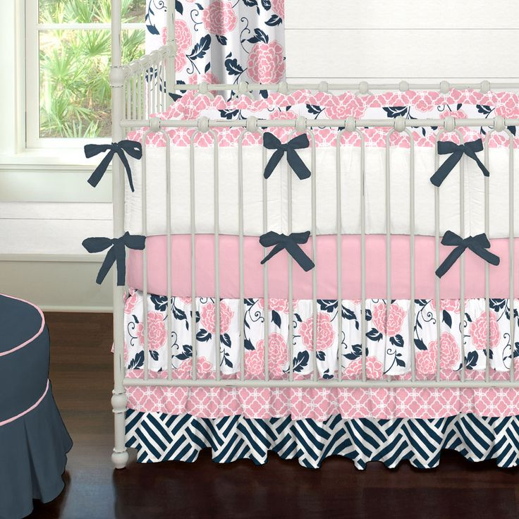 Navy and Coral Ruffles Crib Bedding | Carousel Designs.  A frillier version of our Coral and Navy Floral collection, this crib bedding is a stand-out. Featuring our triple tier ruffled skirt and ruffled crib bumper in contemporary shades of navy blue and coral pink this is truly a must have for your little girls nursery.