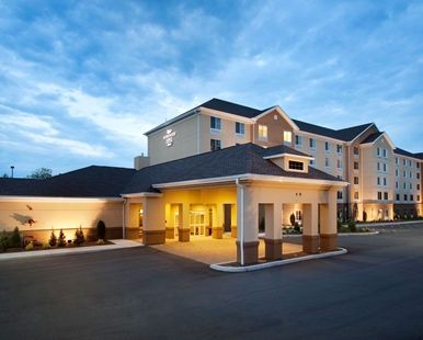 Homewood Suites by Hilton Rochester Greece Hotel, NY - Hotel Exterior at Dusk  | NY 14615