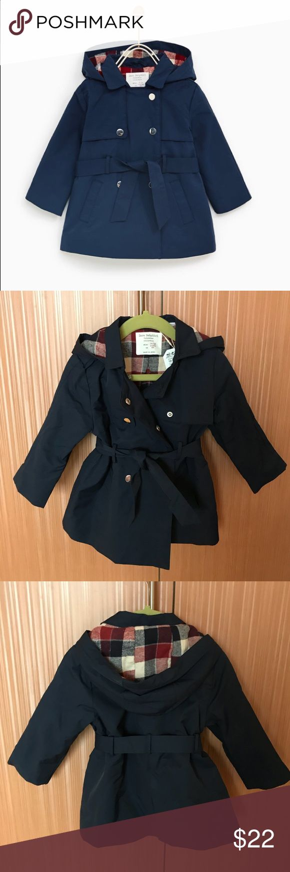 Gorgeous baby girl trench coat NWT 12-18M. Button closure with belt. Hood is attached. Lined with plush cotton lining, adorable checked design. Looks a little like Burberry style coat :)  New with tags attached. Deep blue with red/white checked design lining Zara Jackets & Coats