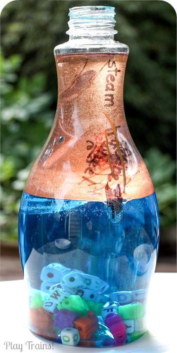 KID SAFE due colori ad olio e acqua Discovery Bottiglie @ Gioca treni!  http://play-trains.com/two-color-oil-and-water-discovery-bottles/ Queste bottiglie di scoperta vibranti contengono olio della lampada, utilizzando tutti gli ingredienti commestibili per renderli sicuri per i bambini a fare loro stessi!