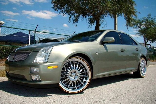Vogues And A Metallic Green 2005 Cadillac Sts Tyres