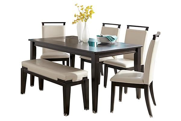 The trishelle dining table from ashley furniture homestore for Sleek dining table designs