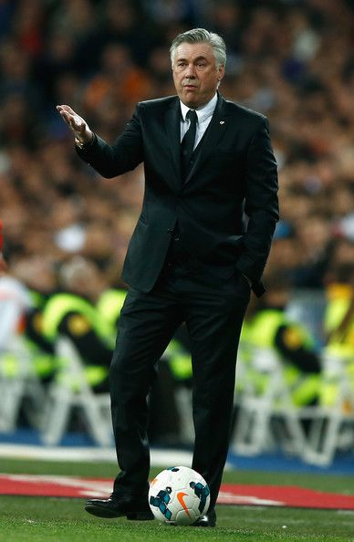 Carlo Ancelotti, coach of Real Madrid gestures during the La Liga match between Real Madrid CF and FC Barcelona at the Bernabeu on March 23, 2014 in Madrid, Spain.