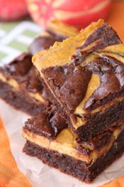 Swirled Pumpkin Cheesecake Brownies. Chocolate brownie with a pumpkin cheesecake batter swirled in. Easy peasy, how exciting!