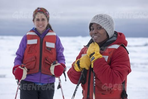 Girl guides Miryam Justo from Peru and Yvette Blankson from Ghana take to the ice close to the Greenpeace ship Arctic Sunrise during their stay on the ship as part of an international crew on a month-long expedition in the icy Arctic.