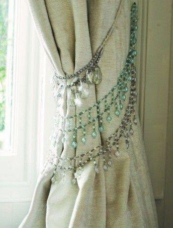 Brilliant décor hack - Use crystal necklaces as a curtain tie back.