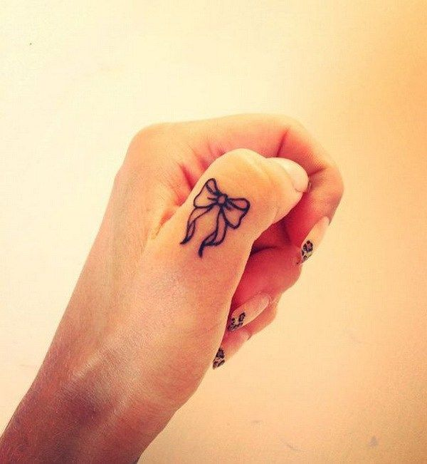 Cute Bow Finger Tattoo.