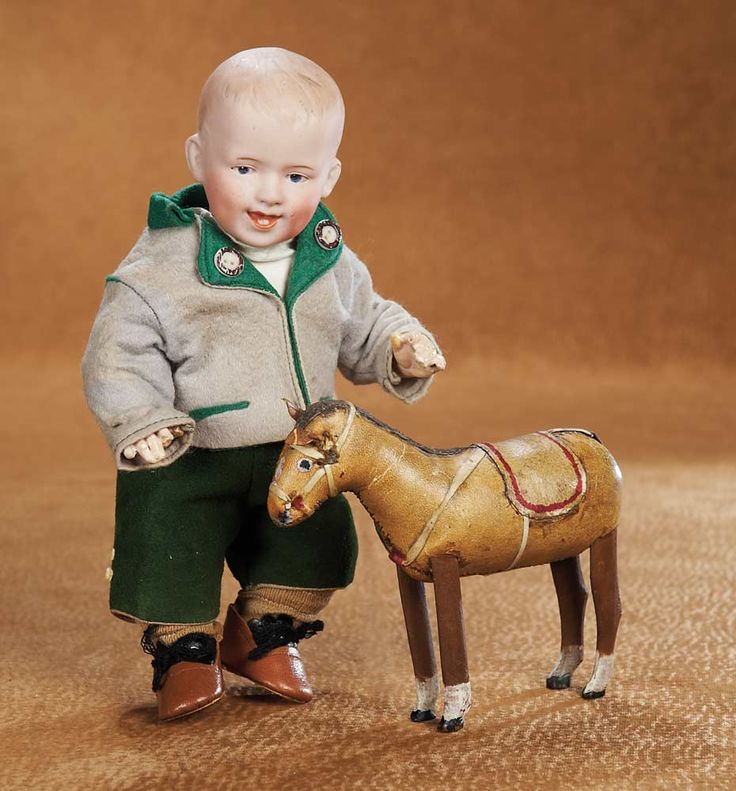 German Bisque Character by Gebruder Heubach with Toy Horse circa 1915