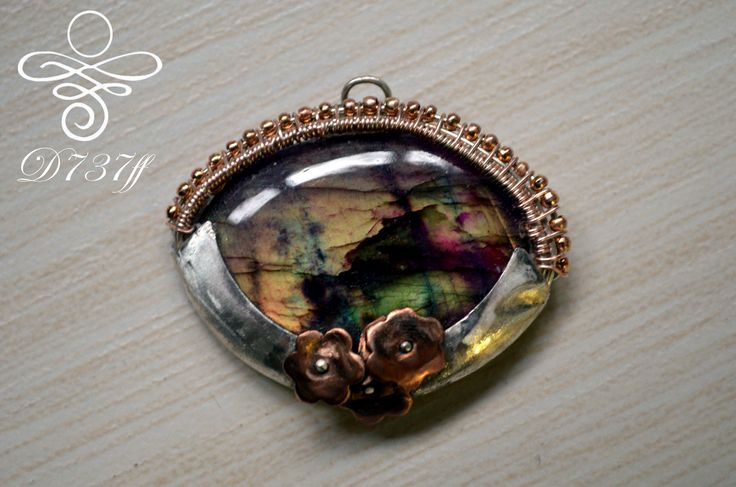 """Pendant """"Autumn Garden"""" A new proposal for a medallion made entirely by hand. Materials used: silver metal clay in rose gold, high quality copper wire silver plated in rose gold color. Dimensions: Length 3.8 cm Width: 4.5 cm"""