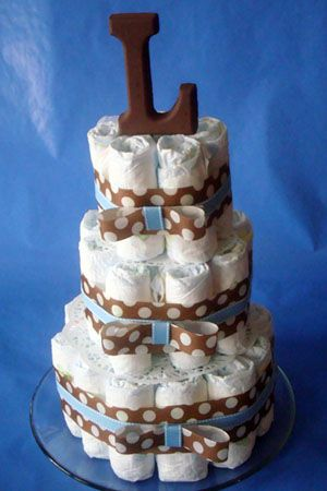 Diaper Cake...to cute.  Could use other items for other celebrations.....bottles of champagne for weddings....