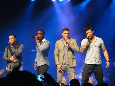 Blue (Lee Ryan, Duncan James, Simon Webbe, and Antony Costa) in concert