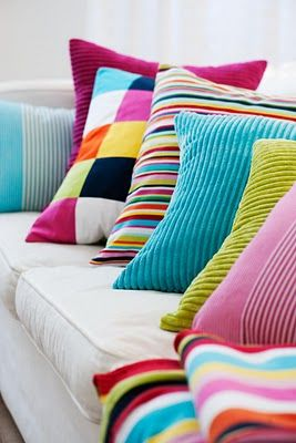 colourful cushions - window seat in our room and guest room day bed