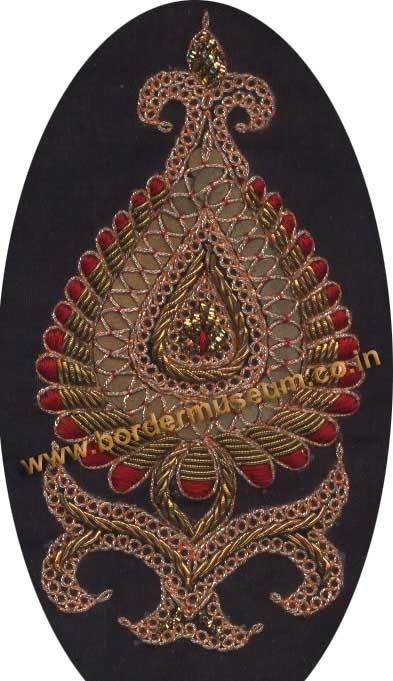 Twisted Zari Marodi work with Antique Zardozi & Red Silk Thread.