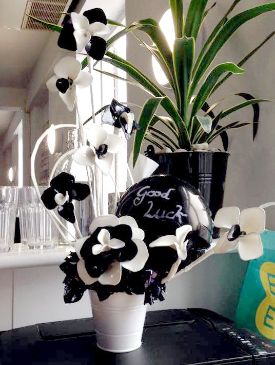 'Good luck' fantasy flowers created from black and white latex balloons, for a local business