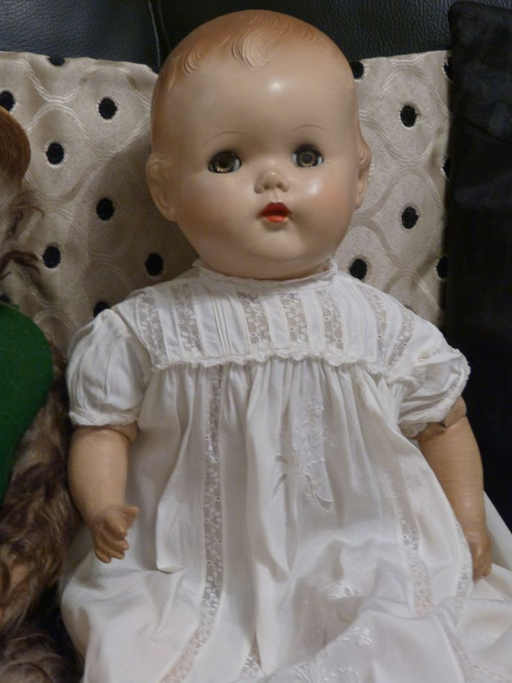Hard plastic and composition doll