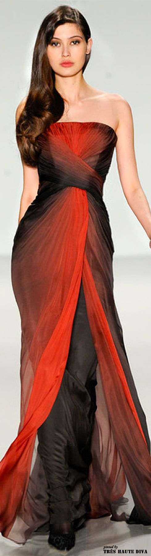 NYFW Pamella Roland Fall/Winter 2014 RTW:  waistlength right-swept wavy brown hair, orange lips, orange/black gradient tulle sleeveless floorlength wrap w/ frontal opening & black tapered underskirt, black heels