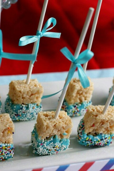 Blue icing rice crispy treats with sprinkles