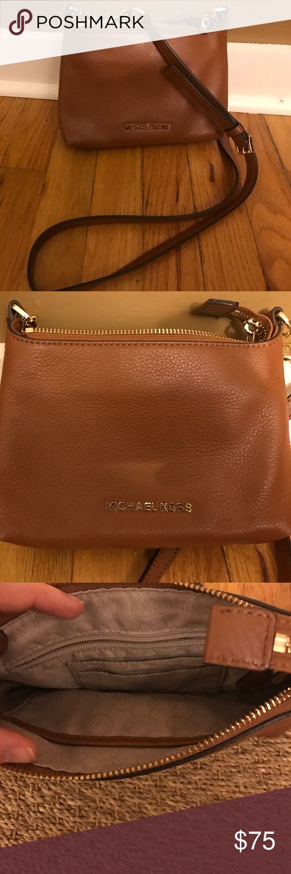 Michael Kors hipster purse All leather beautiful tan Michael Kors purse. This bag is great for on the go! It's in excellent almost new condition. Michael Kors Bags Mini Bags
