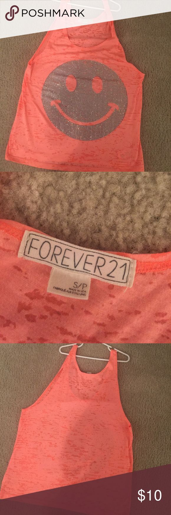 Forever 21 Tank Top Like new Forever 21 Tank Top. Bright orange color with smiley face made up of diamonds. All diamonds are intact. Only worn a couple of times, great condition! Size small. Comes from pet free and smoke free home. Forever 21 Tops Tank Tops