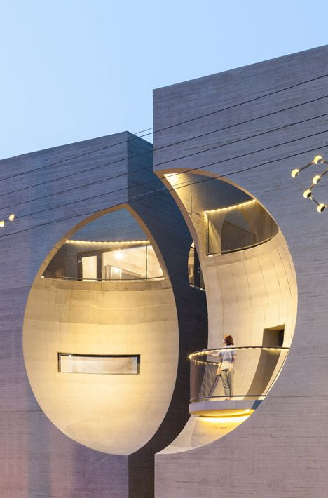 Concave facades on twin buildings by Moon Hoon create moon-shaped indents designed by South Korean architect Moon Hoon //