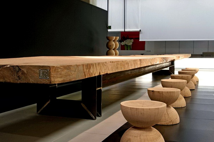 Table in thousand-year kauri wood coming from New Zealand.Iron base designed by Architect Mario Botta for Riva 1920   http://www.riva1920.it/