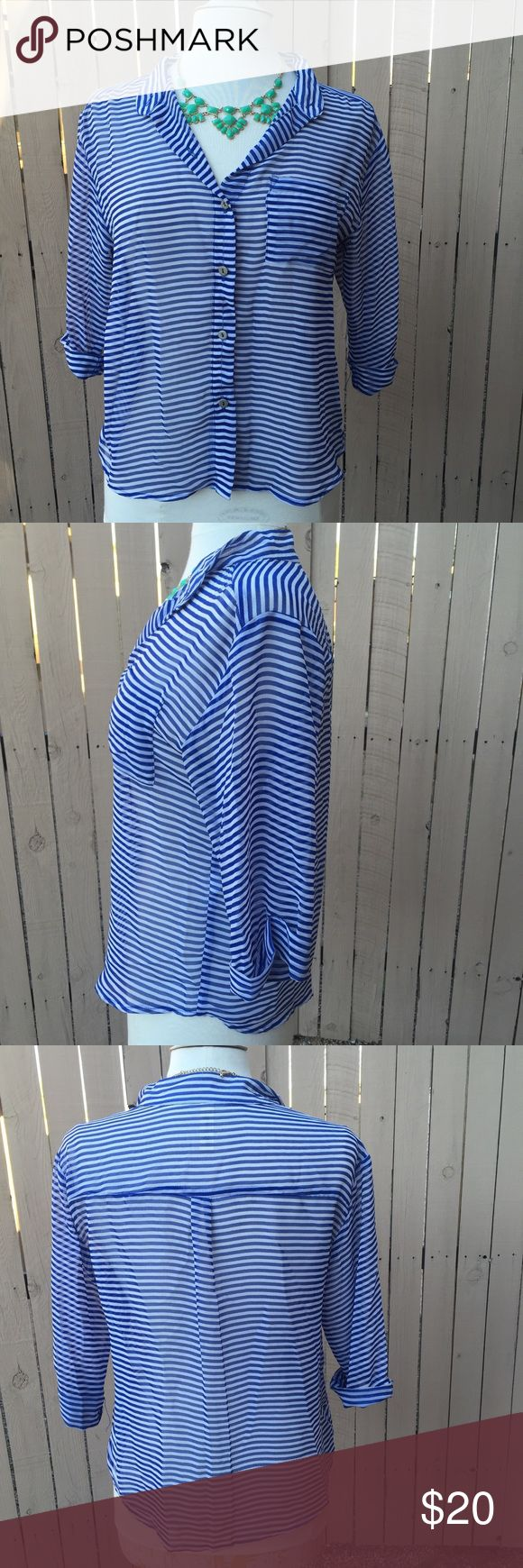 4th of July Blue and White Striped Blouse Blouse is semi sheer- I wear a bra usually underneath it but when I've work it to work I do put a white Cami under. Buttons down. White and blue stripes. See me with any questions ! Francesca's Collections Tops Blouses