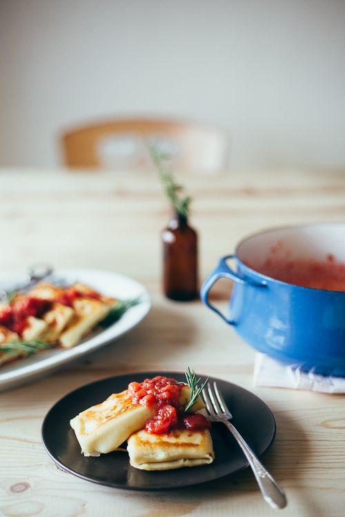 raspberry ricotta blintzes with strawberry rhubarb sauce