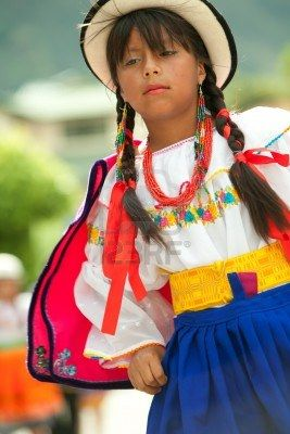 BANOS DE AGUA SANTA,Ecuador - 11 DECEMBER 2010: young girl dressed up in vivid colored clothes performing a traditional dance during autumn festivities that celebrates in Banos De Agua Santa,Ecuador  11 DECEMBER 2010