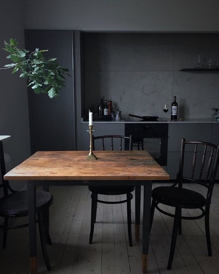 Smokey, broody, intelligent. This kitchen has such a sophisticated feel created with scarce furniture and dark colours.