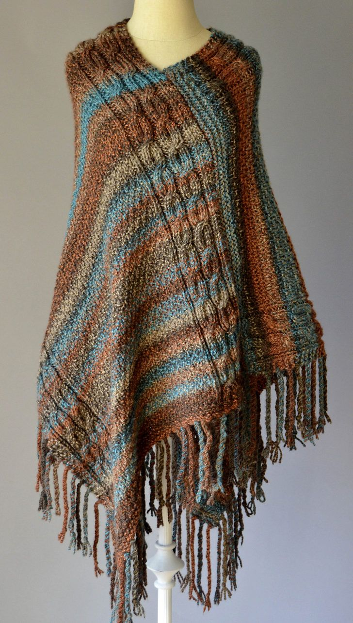 Free Knitting Pattern for Double Cable Poncho - This poncho is made from two rectangles of moss stitch and cables. Quick knit in bulky yarn. Works great with multi-colored yarn.