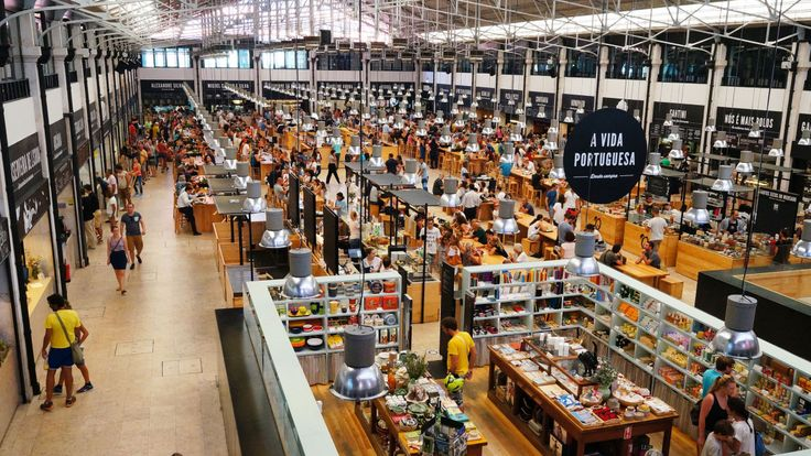 Lisbon's biggest food market....Mercado da Ribeira (6am-2pm, closed Sun)... Among the flowers and regional cheeses, varinas (fishwives), who once sold their wares from flat-bottomed baskets balanced on their heads, offer a selection of cuttlefish and clams, moray eels and sea bass. At weekends handicrafts and antiques are also on offer