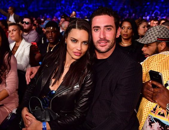 Adriana Lima with her new boyfriend on a boxing match in New York Click on the photo for more