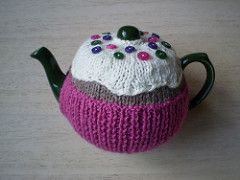 A fairy cake tea cosy to keep your tea hot all through afternoon tea. The main part of the cosy is worked in two halves, one for each side, with the icing being worked separately and sewn on. The fun part is choosing the buttons to decorate your 'cake'. Instructions are included for both three and six cup teapots.