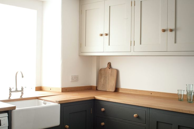 Farmhouse sink next to oak worktop in Shaker style kitchen painted in Farrow & Ball colours