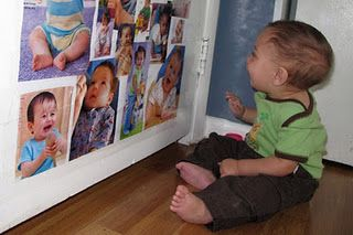 B loves photos of people she knows. This would be easy. Print off from computer. Could be fun to use magnets on the back so she can rearrange them on the fridge.