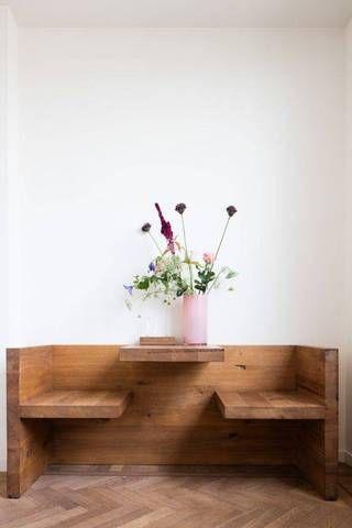 A minimalist, wooden breakfast nook.