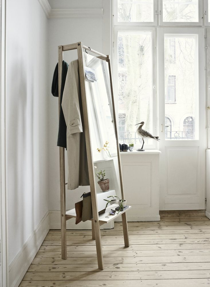 Double up on storage: A mirror, a shelf and hanging space – this multi-tasker keeps clothes and bags you use daily neat and handy. Find more inspiration at housebeautiful.co.uk